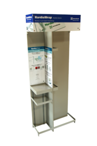 A display with MDF back and panels, shelf standards, a sheet metal shelf, sheet metal product organizers, a sheet metal base, and a 3-sided header